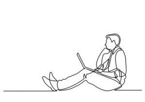Seated man reading Regulation (EU) 2017/1001